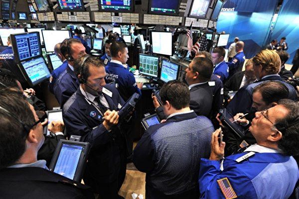 總部位於上海的海銀財富管理有限公司(北京時間)3月26日晚間在美股上市,與其它中概股同現大跌。圖為美國納斯達克股票交易所。(STAN HONDA / AFP / Getty Images)