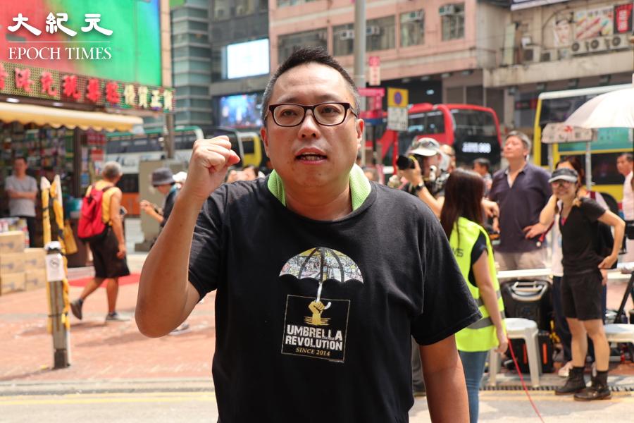 圖為2019年9月29日譚得志參加「全球反極權」大遊行。(黃曉翔/大紀元)