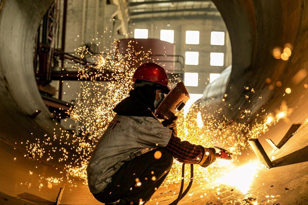 IHS Markit今(4月1日)公佈3月份大陸製造業PMI為50.6,反映製造業商業活動正在擴張。(STR/AFP via Getty Images)