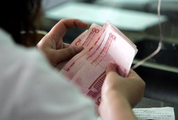在過去10年裏,中國私人企業的債務(不包括銀行)也一再攀升,已達國內生產總值的230%。(Getty Images)