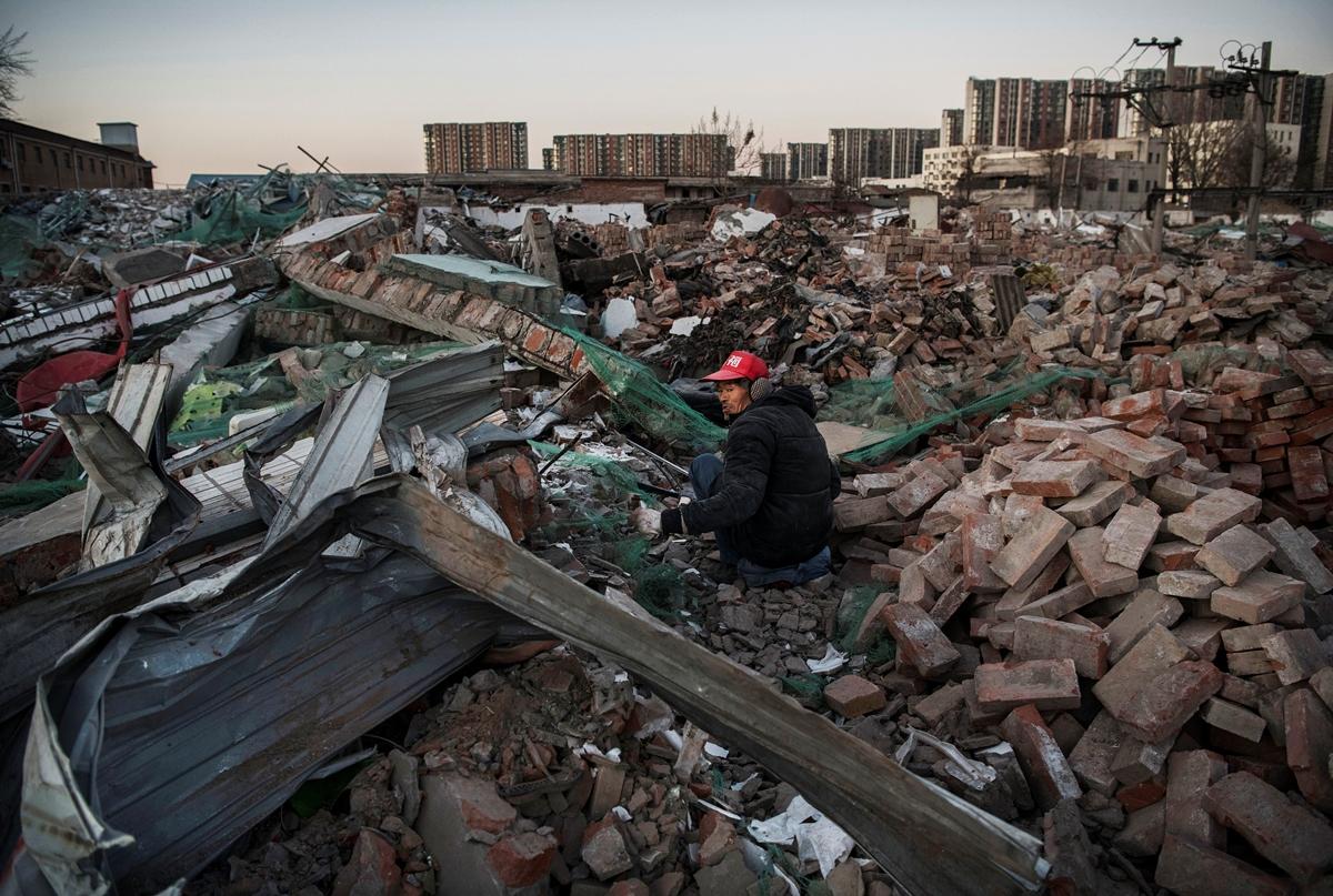 中國大量空置的房屋和眾多行業的產能過剩,這些投資是基於信貸擴張,資金來源主要是依靠舉債。導致中國各個機構出現嚴重的債務問題。(Kevin Frayer/Getty Images)