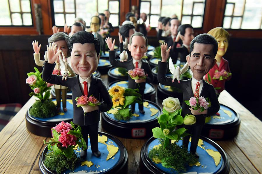 奧習會上是否談及人權備受關注。圖為杭州民間藝人為各國嘉賓創作的捏塑人像。(AFP)