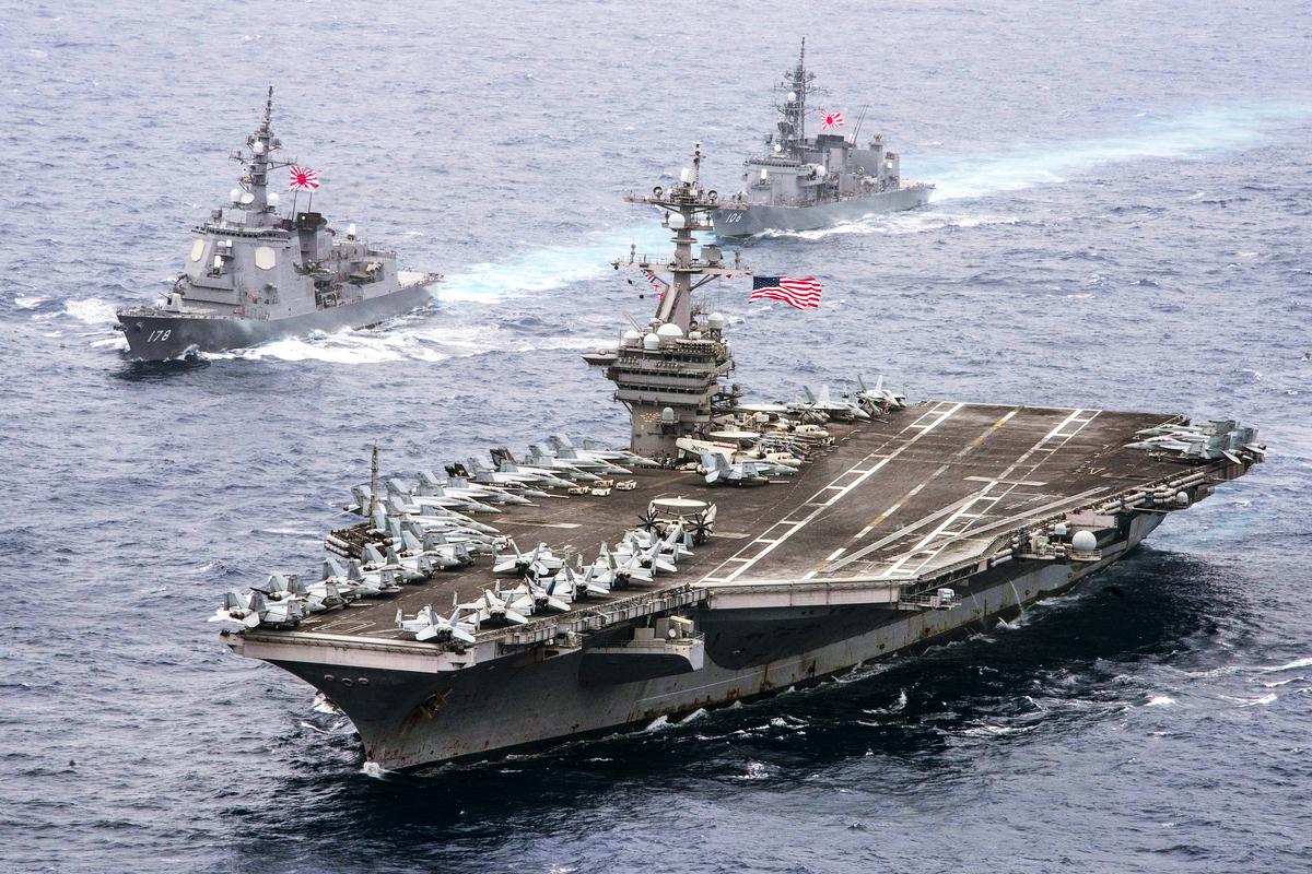 台灣國安局長陳明通表示,中共武力犯台趨勢增加。澳洲防長警告,勿低估台海發生衝突的可能。日本政府已開始討論為台海衝突做準備。圖為往年美日海軍聯合軍演時的情形。(美國海軍)