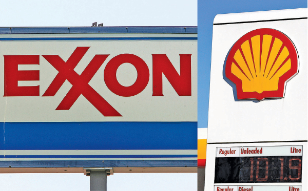 石油公司埃克森美孚(左)和荷蘭皇家殼牌(右)的公司標誌。(Getty Images)