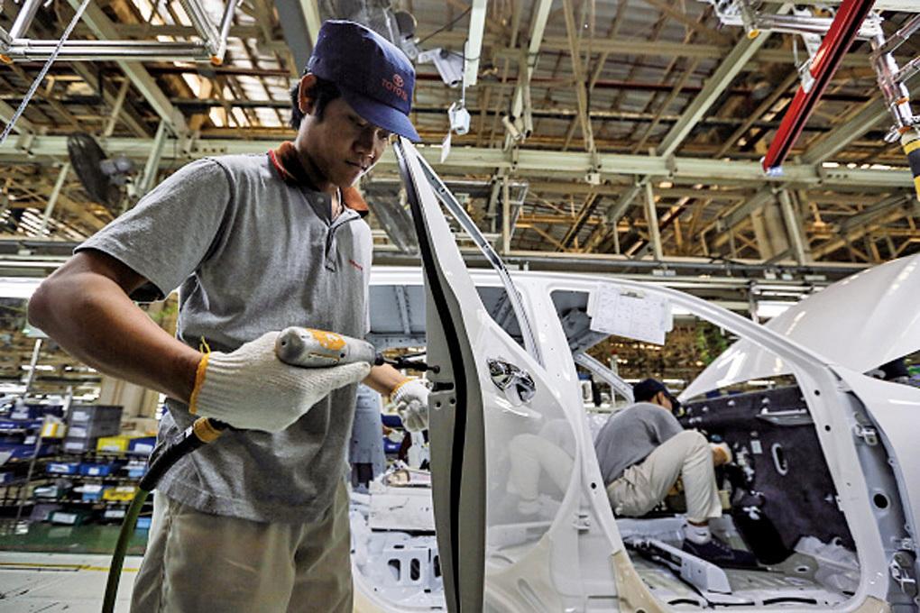 日本政府對企業只存錢不花錢而苦惱,打算對企業的剩餘資金追加課稅,但遭到商工會的強烈反對。(Getty Images)