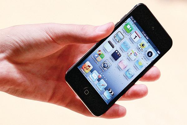 一支iPhone上顯示的應用程式圖標。(Getty Images)