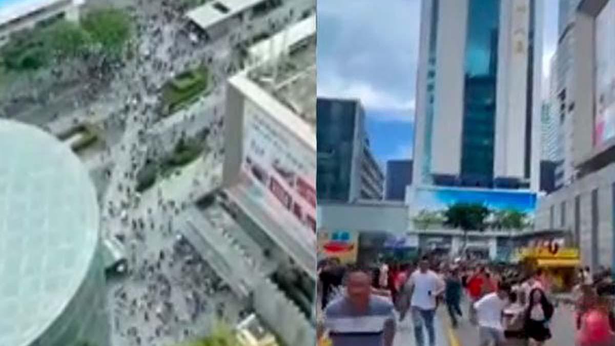 5月18日,深圳市福田區華強北賽格大廈出現不明搖晃,民眾慌忙逃離。(影片截圖)