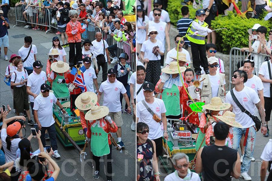 興隆街街坊會仍保留着人手抬飄色的傳統。圖為2019年飄色巡遊情況。(陳仲明/大紀元)