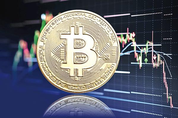 虛擬貨幣市場5月19日遭「血洗」,其中比特幣價格最戲劇化。圖為比特幣模擬圖。(Shutterstock)