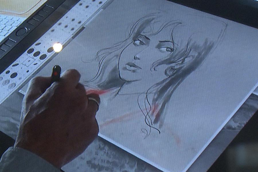 比利時漫畫藝術中心展覽漫畫技術的發展,從黑白、彩色,到現在用電子設備作畫。(新唐人)