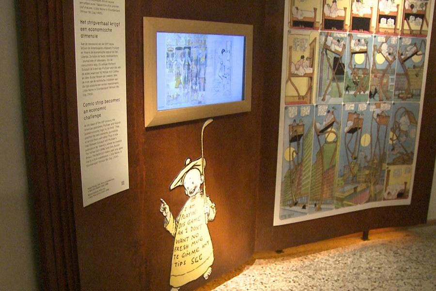 比利時漫畫藝術中心裏對19世紀末紐約著名的漫畫人物「黃孩子」的介紹。(新唐人)