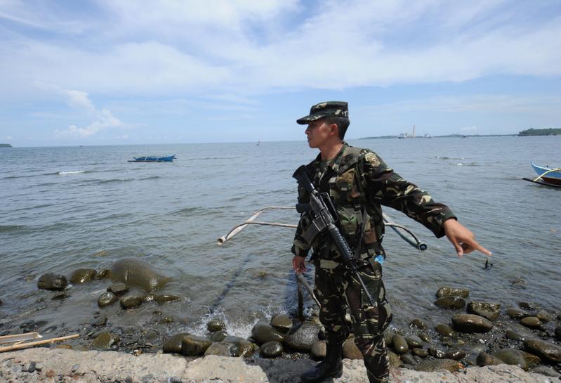 黃岩島離菲律賓北部海岸140英哩,這座小礁島近來卻成了中菲主權爭議的主角。(TED ALJIBE/AFP/GettyImages)