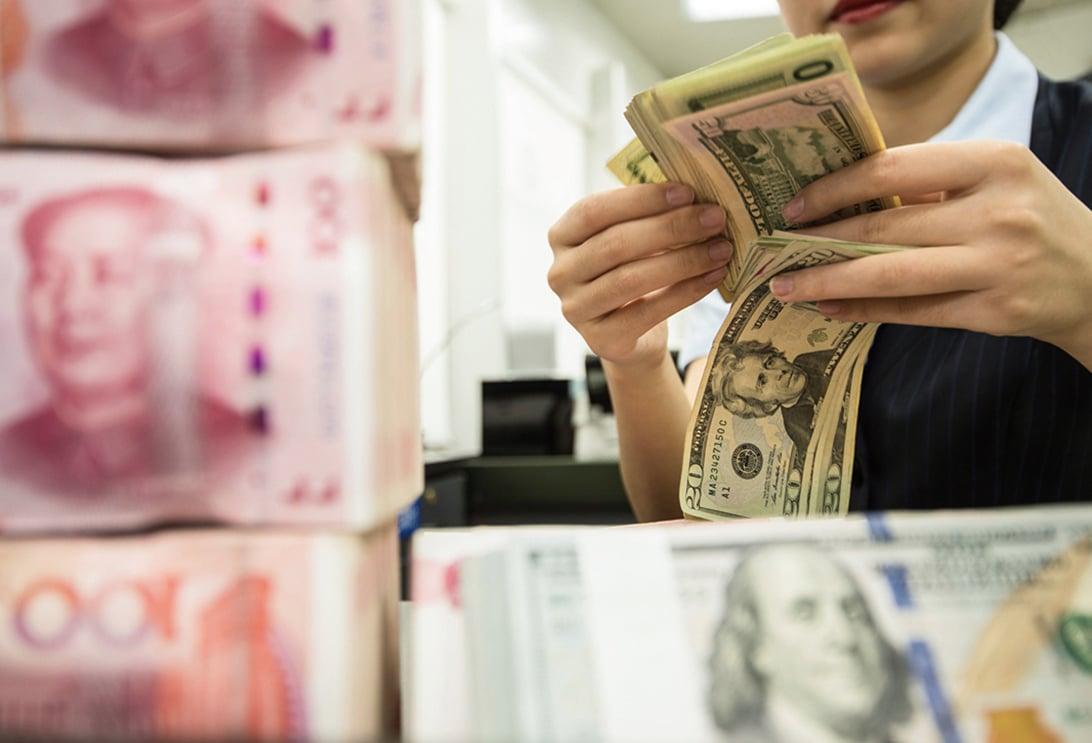 中共當局持續發聲為匯率降溫。(STR/AFP via Getty Images)