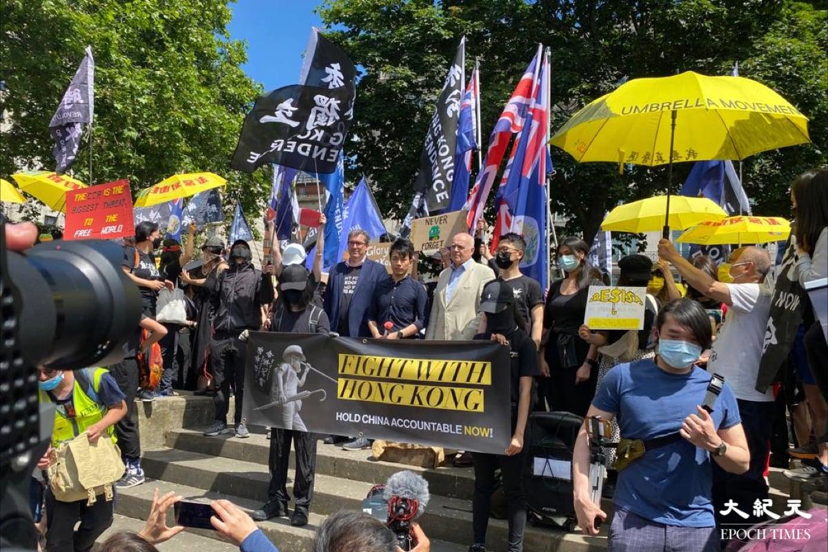 6.12兩週年,倫敦三千人集會遊行支持港人抗共。(宴寧/大紀元)