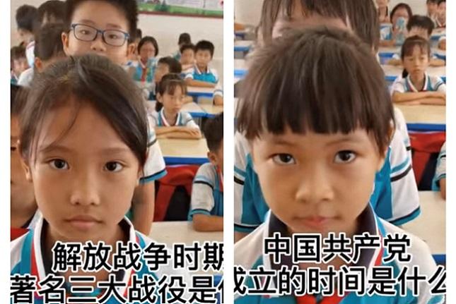 大陸一所小學校,學生排隊逐個回答建黨百年知識問答。(視頻截圖)