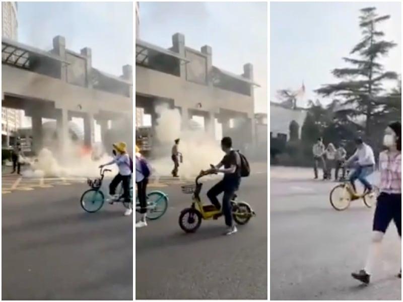 外交部門前有民眾縱火抗議,隨即被抓。(視頻截圖,大紀元合成)