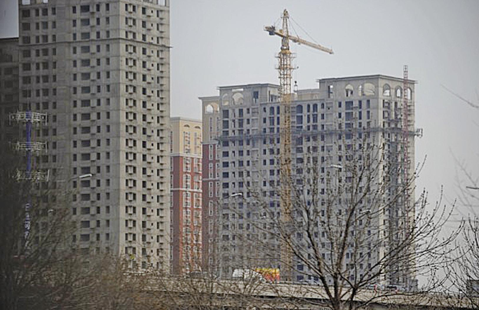 中國房地產市場繁榮建立在過度金融槓桿的基礎上,風險一定是巨大的。(AFP PHOTO / WANG ZHAO)