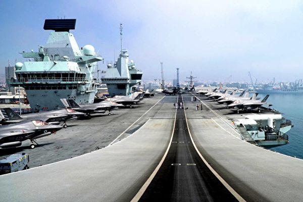 2021年7月1日,英國皇家海軍「伊利沙伯女王」號航母前往印太地區,途徑利馬索爾新港。(Roy Issa / AFP Getty Images)