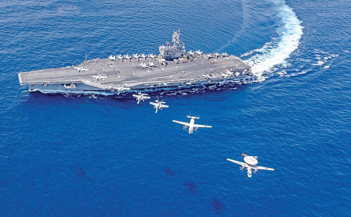 目前美軍在南海及附近區域動作頻頻,分析認為,這一方面是挑戰北京在南海的擴張,另一方面也是為台灣危機做準備。圖為美國列根號航母在南海。(美國海軍提供)