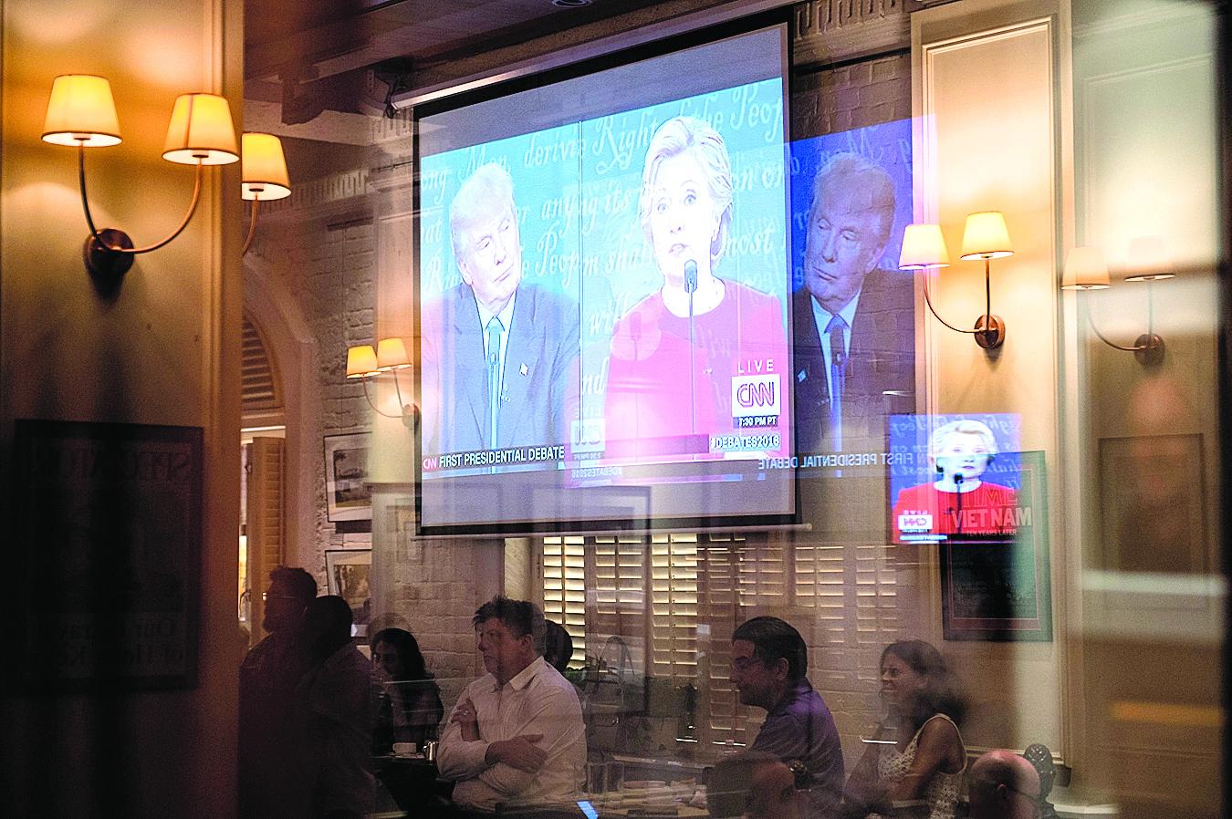 美國總統大選首場電視辯論吸引超過8千萬觀眾收看,打破歷屆紀錄。(AFP)