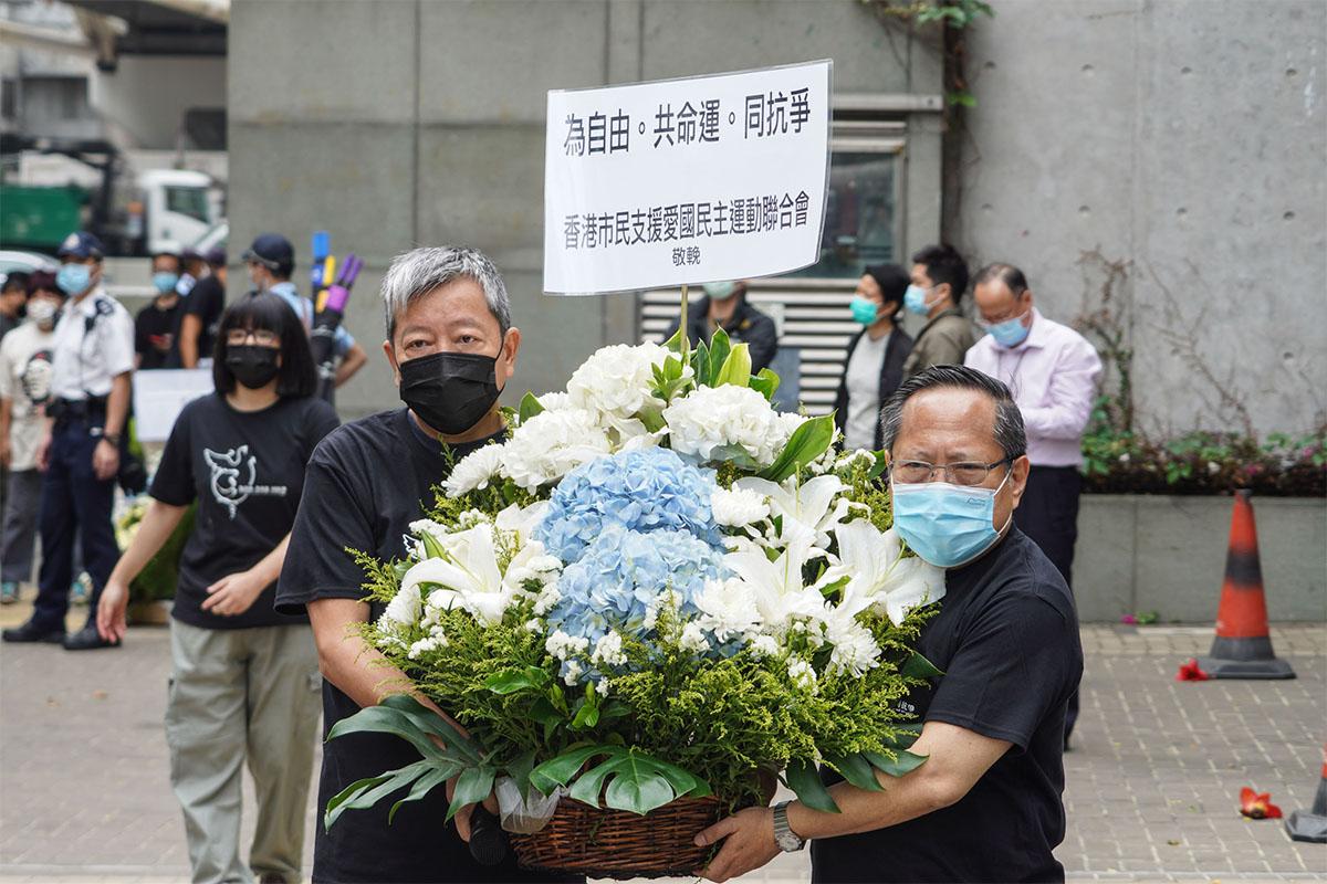 正在獄中服刑的支聯會主席李卓人(左)及前副主席何俊仁昨日聯名發表公開呼籲信表示,就當前的社會環境,「我們認為:支聯會最好的處理方案,就是主動解散。」(大紀元資料圖片)