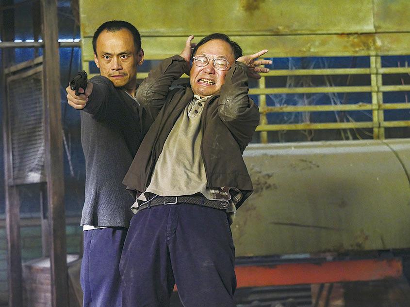 許冠文在電影《一路順風》飾演的士司機劇照。(資料圖片)