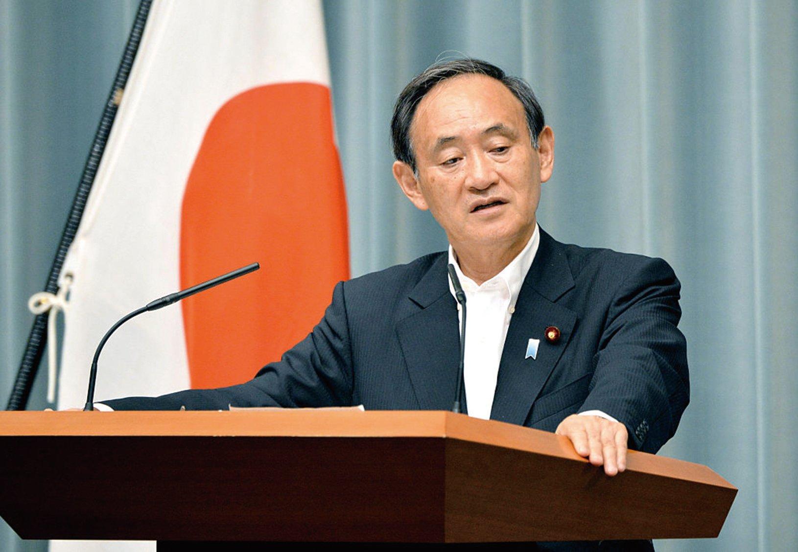 針對南韓媒體報道有2名北韓駐華高官攜眷欲脫北赴日,日本官房長官菅義偉否認有北韓官員向日本投誠。(AFP)