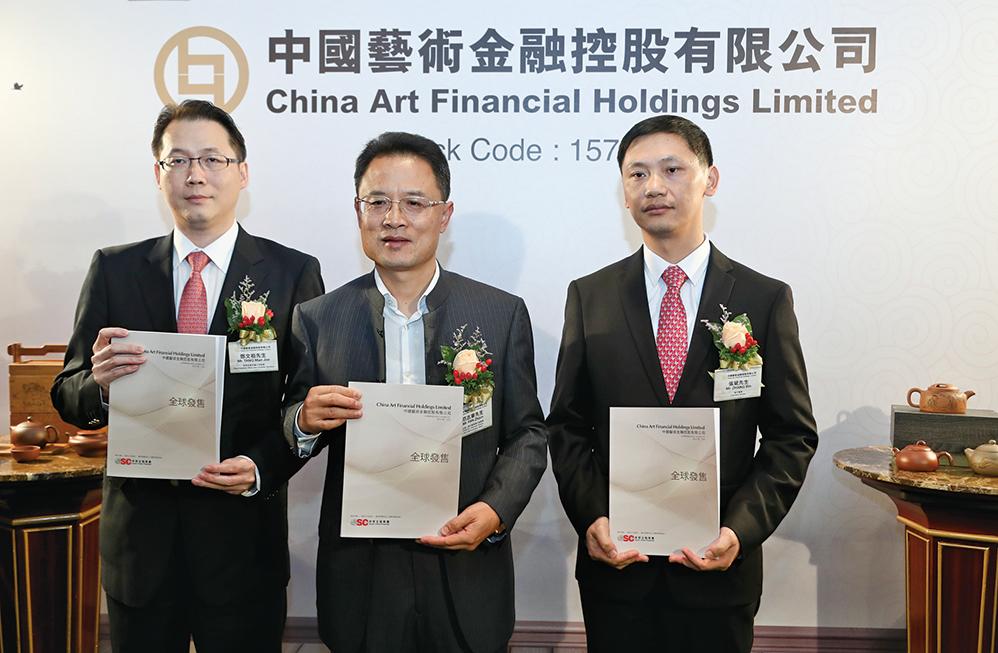 左起中國藝術金融首席財務官鄧文祖、主席范志軍、執行董事張斌。(余鋼/大紀元)