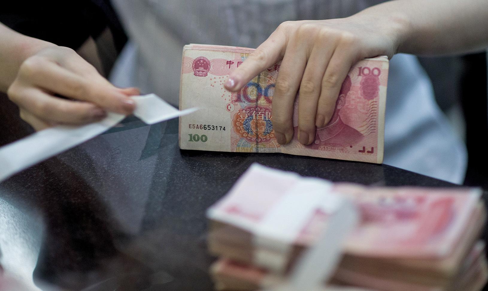 受中美貿易談判消息刺激,5月6日人民幣一度大跌。(AFP)