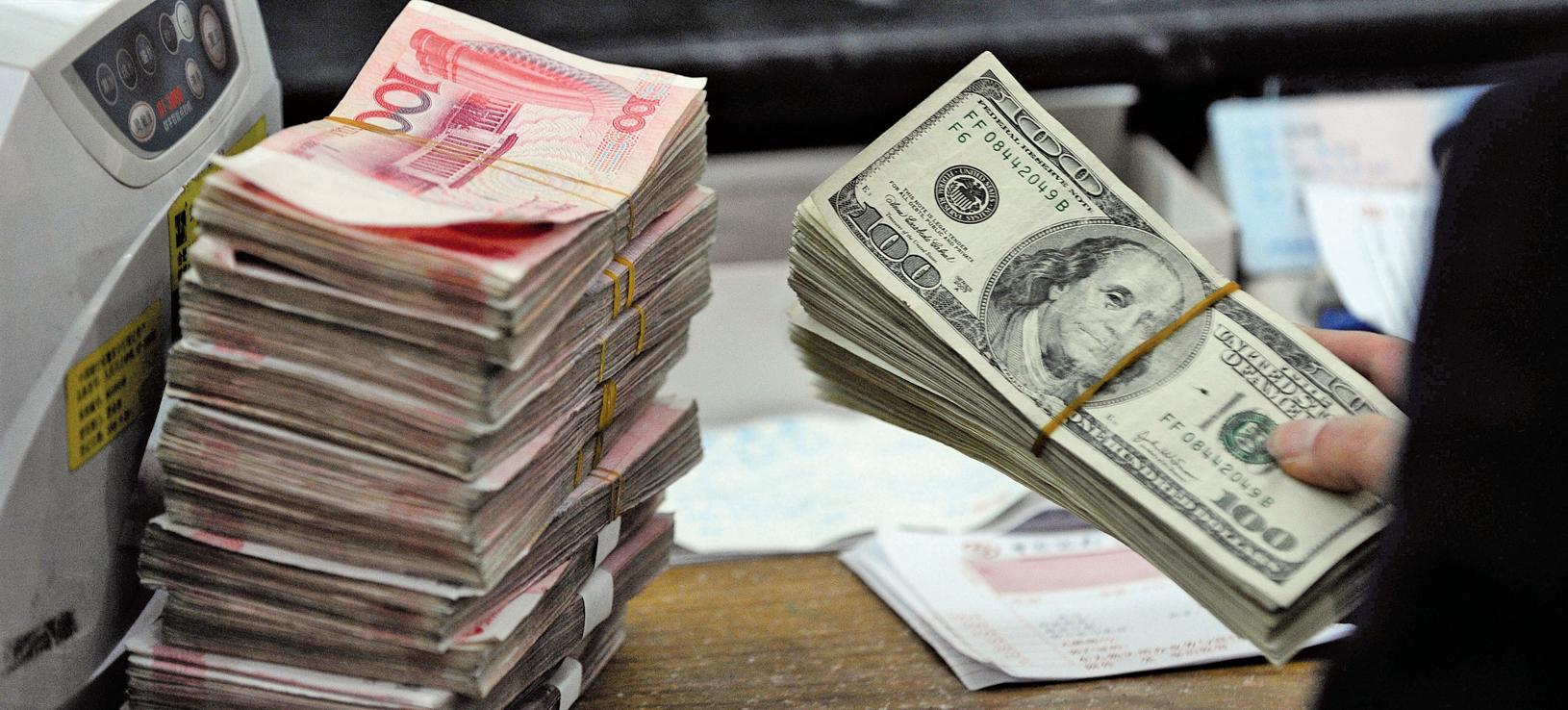 人民幣兌美元近來持續貶值破紀錄,市場看空氣氛濃厚。(Getty Images)