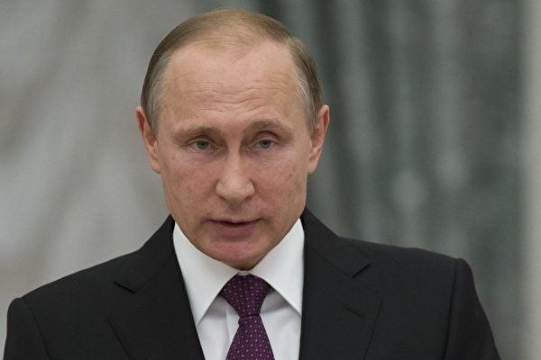 俄羅斯總統普京於12月1日在俄羅斯聯邦的國家年度國情報告中說,俄羅斯正在找朋友,渴望與美國合作,因為莫斯科和華盛頓對全球安全負有共同的責任。(PAVEL GOLOVKIN/AFP/Getty Images)