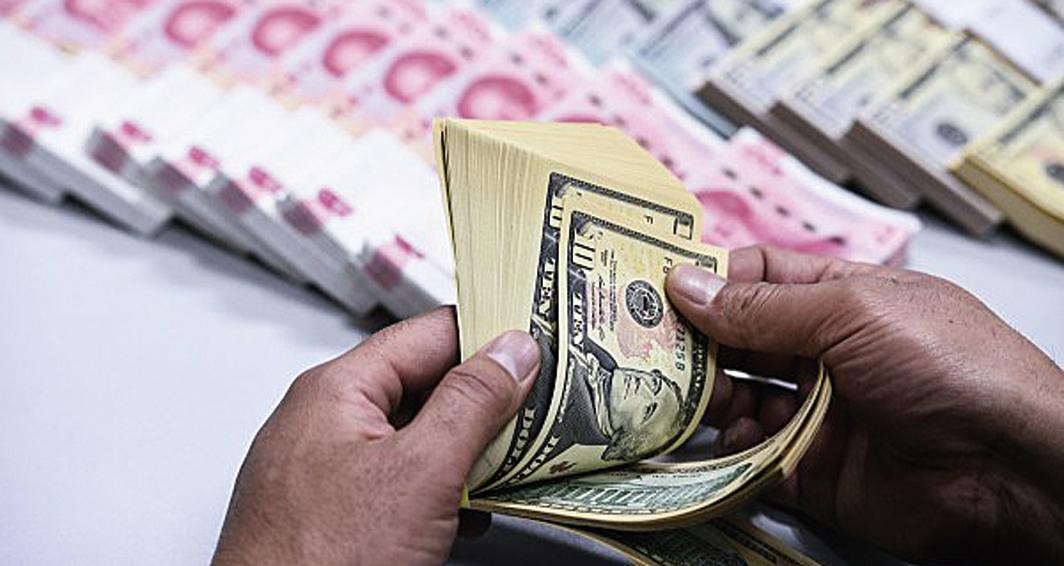 從今年初以來,人民幣兌美元匯率已經累計貶值近6%。(大紀元資料圖片)