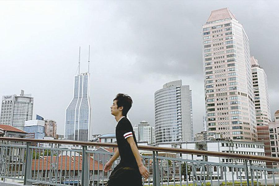 陸媒分析文章稱,貿易戰爆發總體對中國不利,在三種情況下,大陸樓市將面臨三種選擇。(資料圖片)