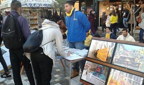 希臘法輪功學員舉辦反迫害傳真相活動