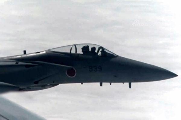 中共軍媒短片顯示,12月10日中方戰機和日方F-15戰機曾非常接近。(網絡圖片)