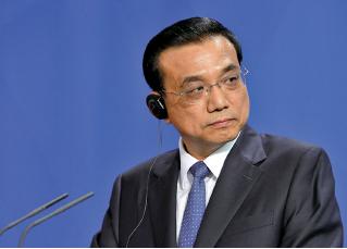 李克強在猴年首次工作會議上的講話透露出中國經濟面臨的困境。(Adam Berry/Getty Images)