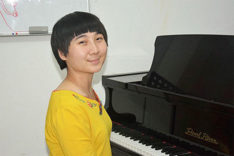 修煉法輪功一年的北京鋼琴老師單珊11月26日遭非法綁架。(明慧網)