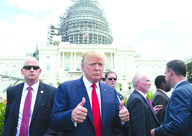 特朗普所屬的共和黨控制參眾兩院。但無論來自民主黨的杯葛,還是來自共和黨內部的異見,都可能給特朗普施政造成障礙。(AFP)