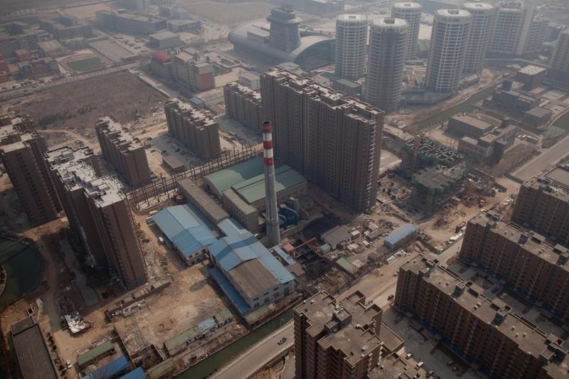 市場分析人士將大陸的空置房分為兩類,一類是中小城市過剩的房產,一類是房產投機者囤積、待炒作的房產。空置房問題已經成為大陸房地產市場的風險之一。(Ed Jones/AFP/Getty Images)