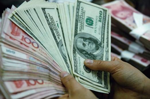 大陸外匯儲備繼續減少,當局有可能敦促國有企業結匯。(Getty Images)