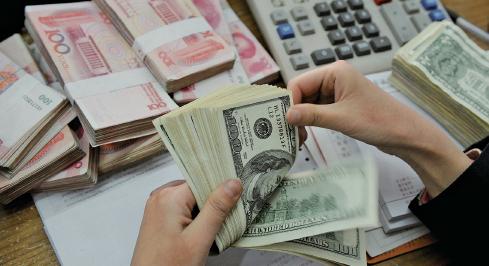 中共央行18日公佈,截至今年1月底,央行口徑人民幣外匯佔款,按月下降6,500億元人民幣,屬史上第二大跌幅。(Getty Images)