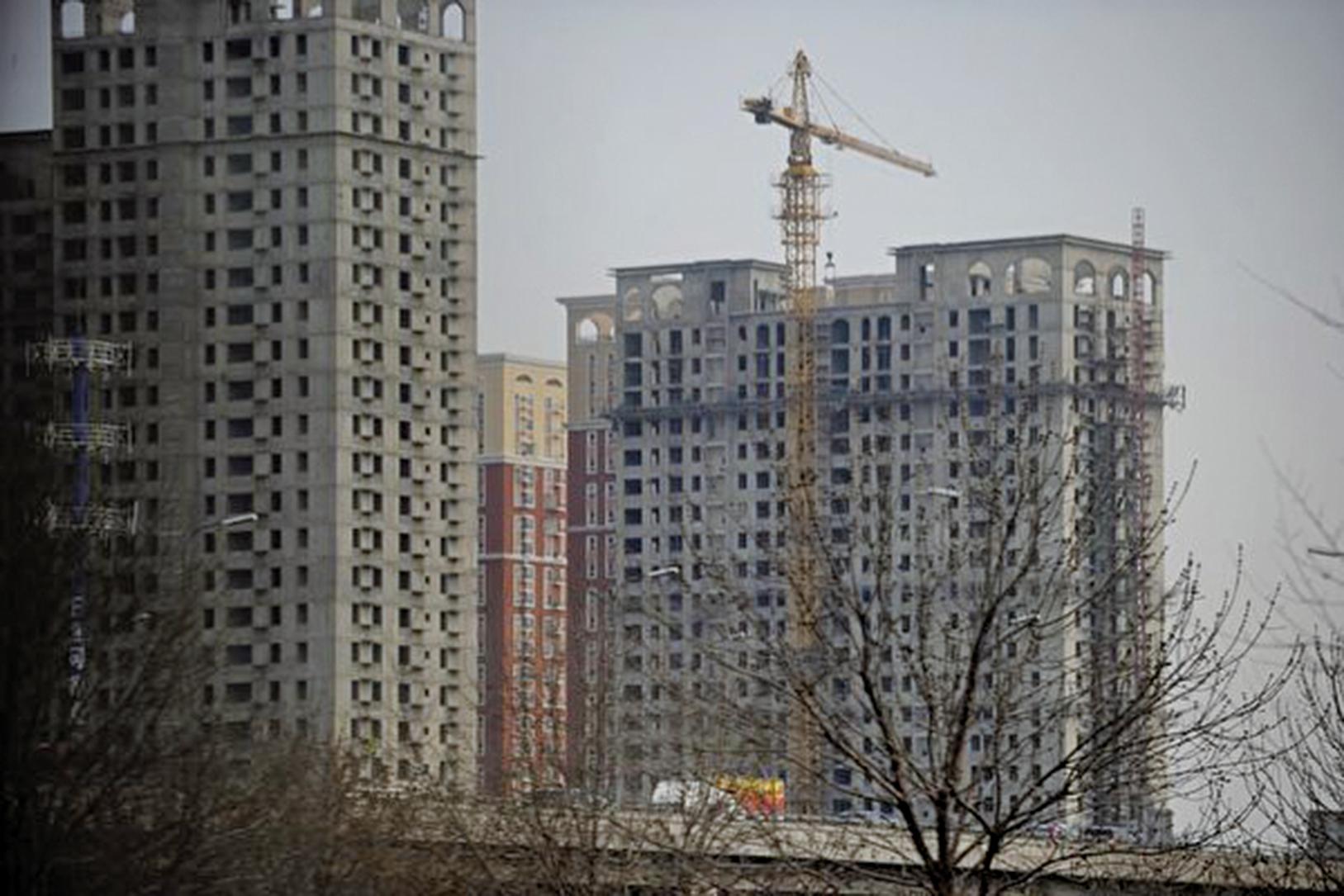 如果房價得不到抑制,可能會有更嚴厲的樓市調控措施出台。(WANG ZHAO/AFP)