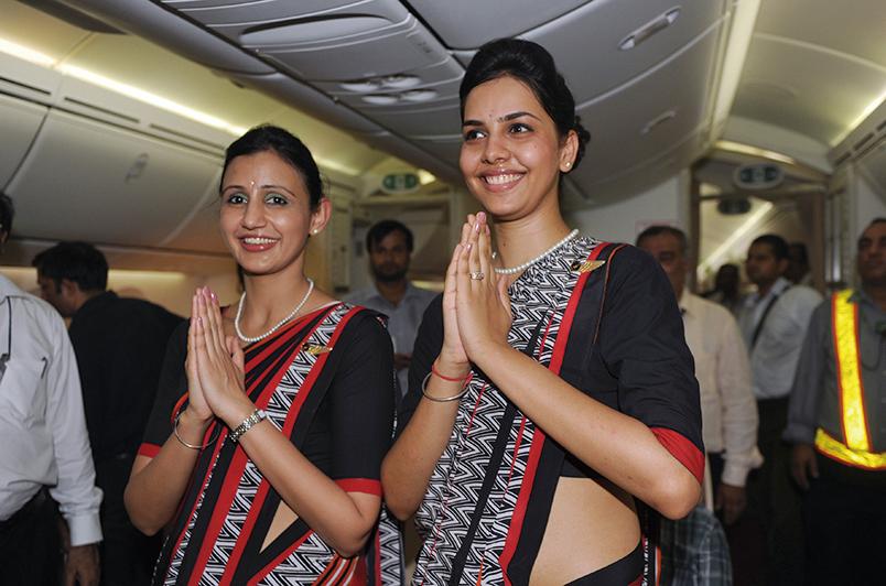 圖為印航空姐。(RAVEENDRAN/AFP)