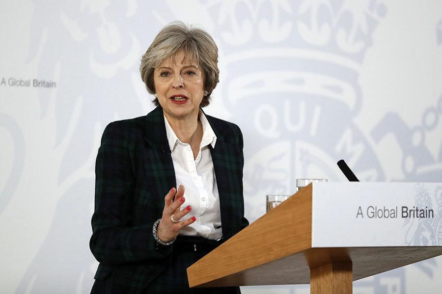 英國首相文翠珊1月17日出席記者會,就英國脫歐進程首度發表公開演講,並短暫回答記者提問。(KIRSTY WIGGLESWORTH/AFP/Getty Images)