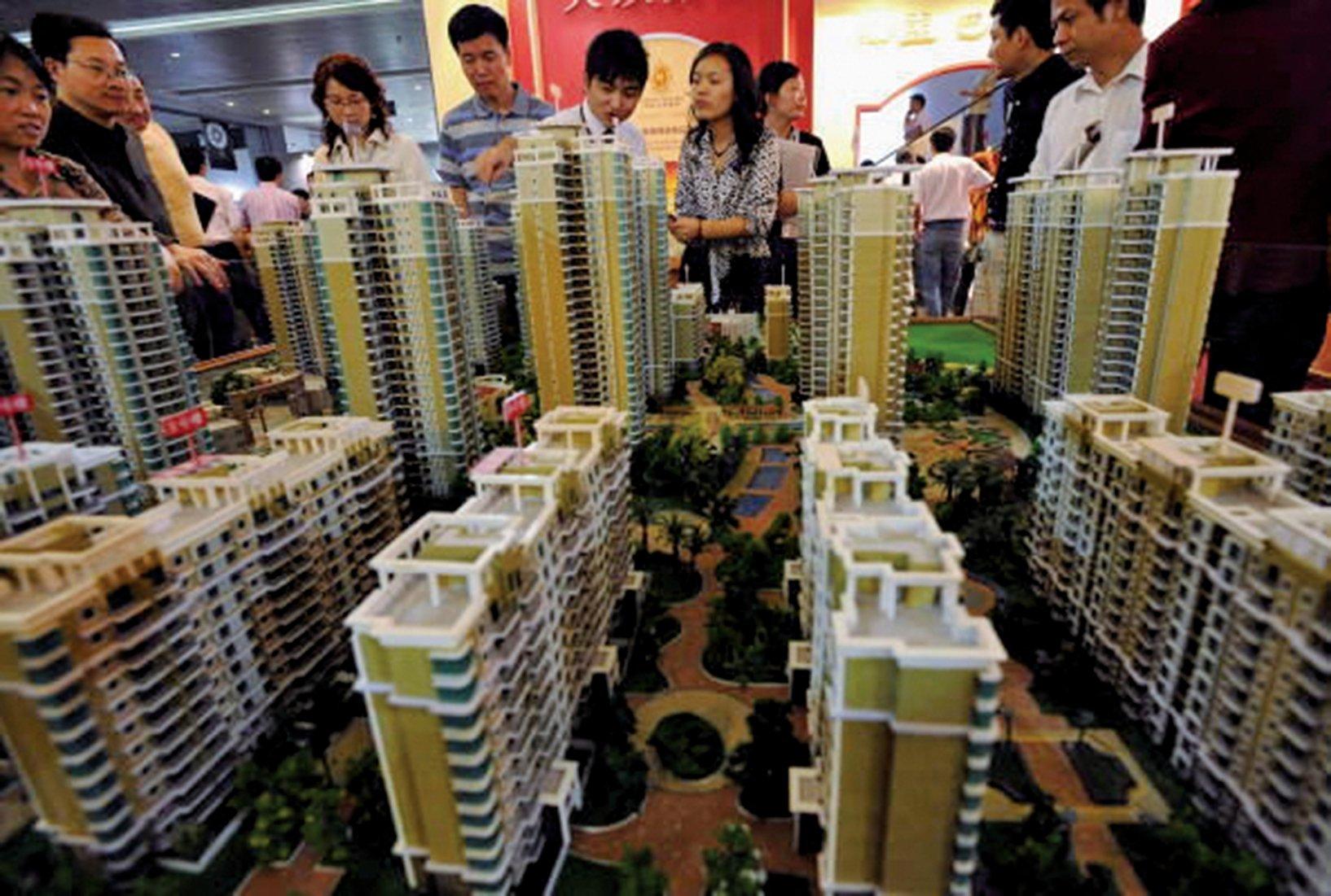 大陸多個熱點城市的地方政府工作報告把「保持房地產市場的穩定」的位置提前。(Getty Images)