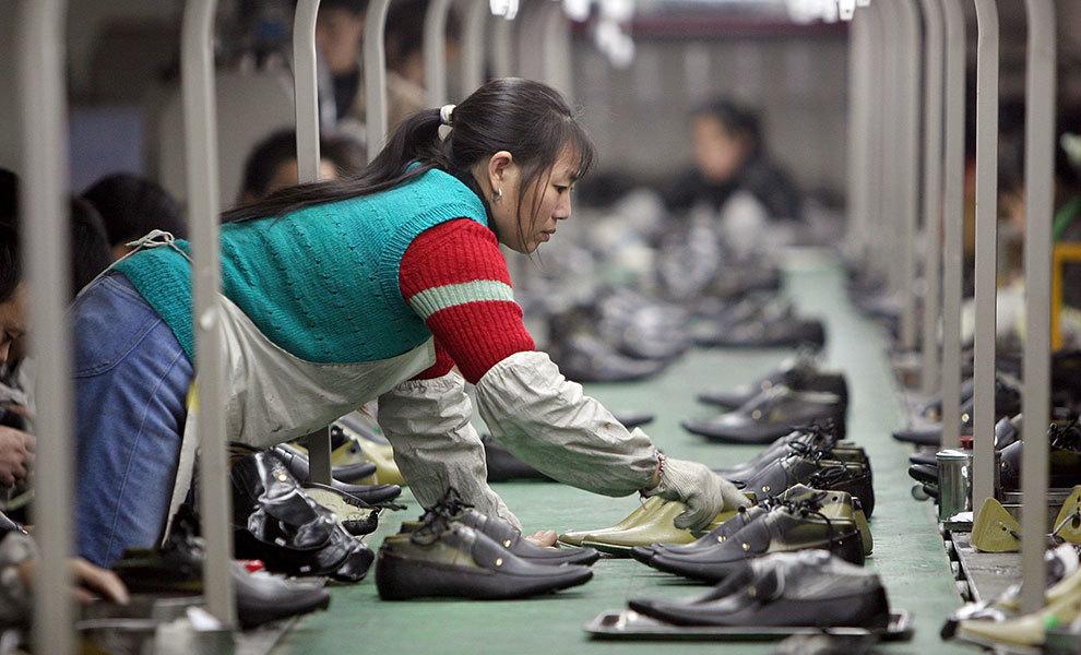即使美國退出了TPP,中共也無法取代美國的貿易地位,因為它的貿易壁壘和缺乏法律保護,將扼殺它領導全球商業的企圖。(China Photos/Getty Images)