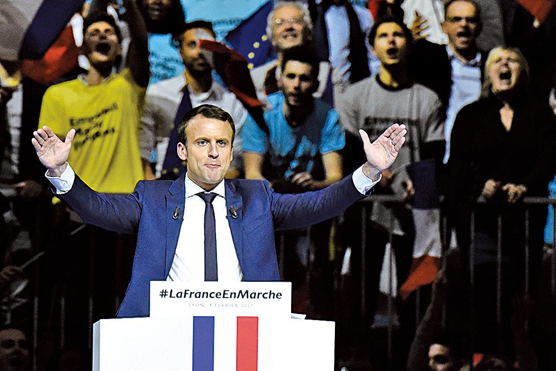 圖為2月4日,法國中間派總統候選人馬克隆在里昂舉行造勢會。(AFP)