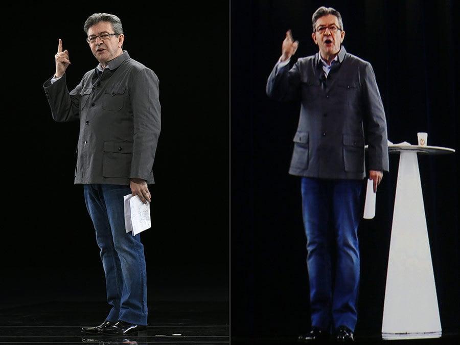 圖左為梅郎雄真人在里昂,圖右為他的投影在巴黎的會場上。(JEAN-PHILIPPE KSIAZEK,THOMAS SAMSON/AFP/Getty Images)