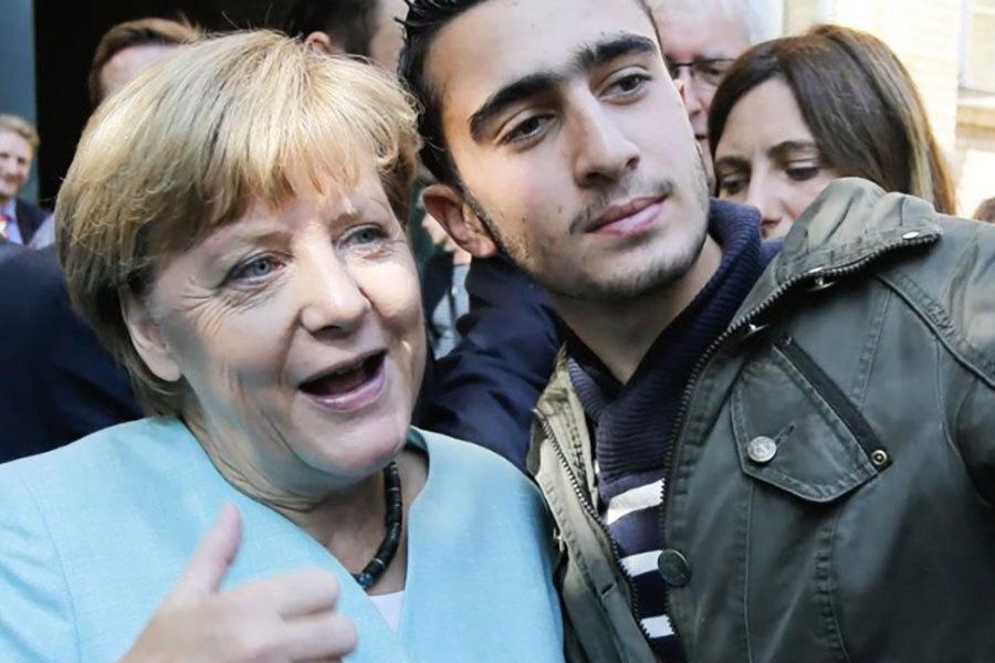 與默克爾合照遭誹謗 敘利亞難民告Facebook