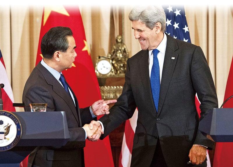 美國國務卿克里和到訪的中共外長王毅會談後表示,就聯合國安理會制裁北韓的磋商取得「重要進展」。(AFP)